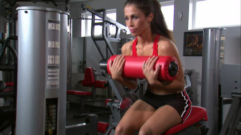 Woman doing sitting curls on an exercise machine Footage