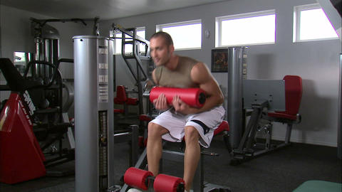 Man doing sitting curls with an exercise machine Footage