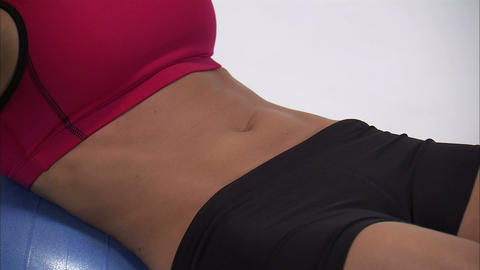 Royalty Free Stock Footage of Close up of a woman's stomach as she does sit-ups  Footage