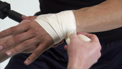 Close-up of a man's hands getting taped before boxing Live Action