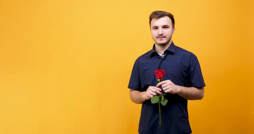 Confident man with a rose GIF