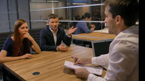 Attractive businesspeople meeting in office boardroom Footage