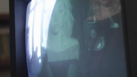 Colorful reflection of girl on old TV display playing… Stock Video Footage