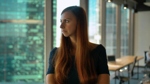 Portrait of young successful redhair woman entrepreneur standing in office. Huge ビデオ
