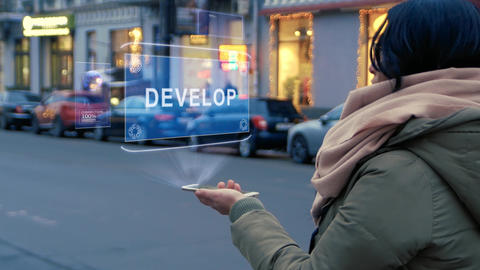 Unrecognizable woman standing on the street interacts HUD hologram with text Live Action