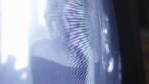 Blonde pretty girl with smile is displayed on surface of old-fashioned TV screen Footage