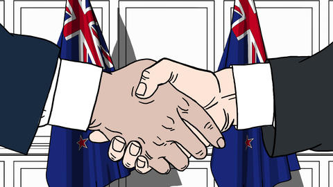 Businessmen or politicians shake hands against flags of New Zealand. Official Footage