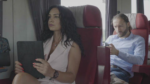 Technology addiction of millennial office dressed man and woman commuters on Footage