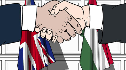 Businessmen or politicians shake hands against flags of Great Britain and Live Action
