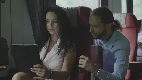Business coworkers man commuter and woman working and consulting together about ビデオ