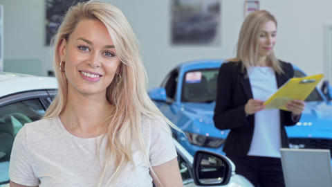 Gorgeous happy woman smiling, holding car keys after buying new auto Live Action