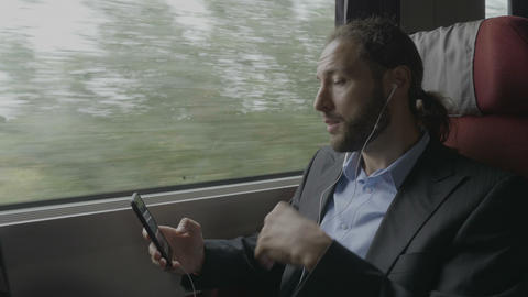 Confident young entrepreneur man traveling by train having a business video call Footage