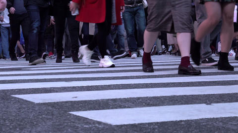 Feet of people crossing the famous Shibuya intersection at evening Footage
