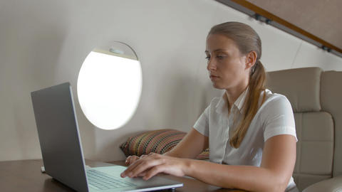 Air hostes asking businesswoman about service inside of private jet cabin Footage