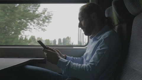 Office millennial male employee traveling by train to work having a video call Footage