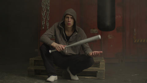 Mean guy holding baseball bat with threatening look Live Action