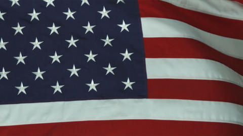 Close up of the blue star field of the American flag rolling in the wind Footage