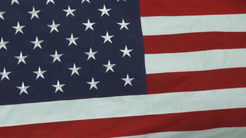 Close up of the American flag rolling in the wind Footage