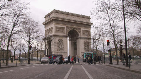 People crossing the street at the the Arc de Triomphe in Paris France Footage