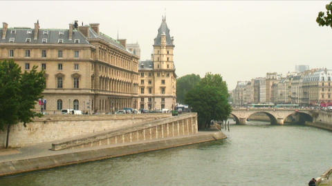 Parisian building seen across the Seine River in France Live Action