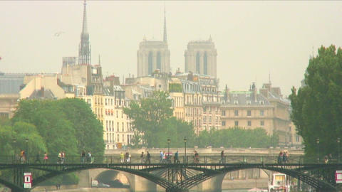 Royalty Free Stock Footage of Pedestrian bridge over the Seine with Paris skylin Live Action