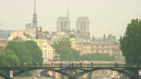 Royalty Free Stock Footage of Pedestrian bridge over the Seine with Paris skylin Footage