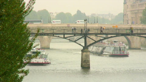 Ferries going under bridges on the Seine River in Paris Footage