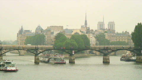Royalty Free Stock Footage of Ferries going under bridges on the Seine in Paris, Live Action
