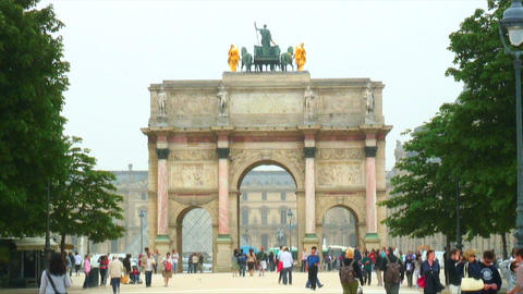 People walking by the Louvre Museum entrance Footage