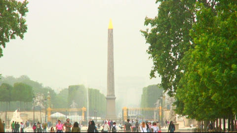 People walking near a monument in Paris Live Action