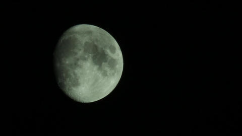 Moon round that sees behind some thin clouds which runs the sky 18 Live Action