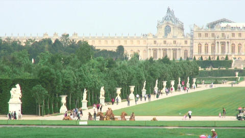 Large lawn surrounded by statues at Versailles France Live Action