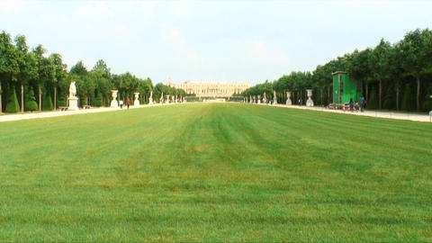 Royalty Free Stock Footage of Long lawn surrounded by statues and a walkway in P Live Action