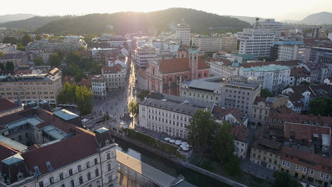 Aerial - Buildings, river channel and the city square at sunset Footage