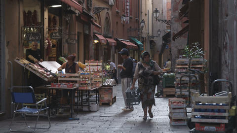 Panning shot of an alley market in Bologna Italy Footage