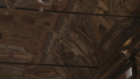 Painted ceiling and a chandelier in Bologna Italy Live Action