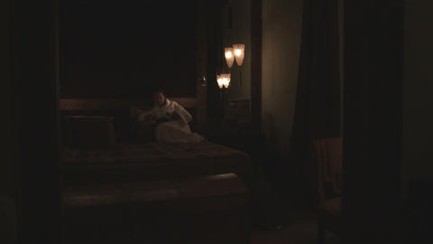 Woman reading in bed at an Italian hotel Footage