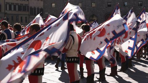 Clip of men in fancy attire in a parade in Italy Footage