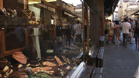 People walking by a jewelry display window in Italy Live Action