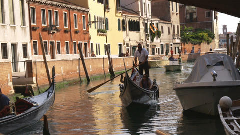 Tourists in a gondola on a canal in Venice, Italy Footage