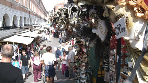 Masks at a street market in Venice Italy Footage