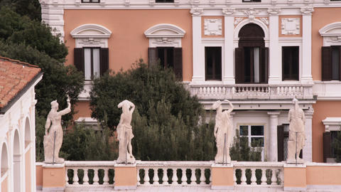 Statues on the roof of a building in Rome Italy Live Action