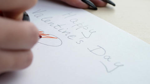 Woman writing letter with red pencil at Valentine's Day ビデオ