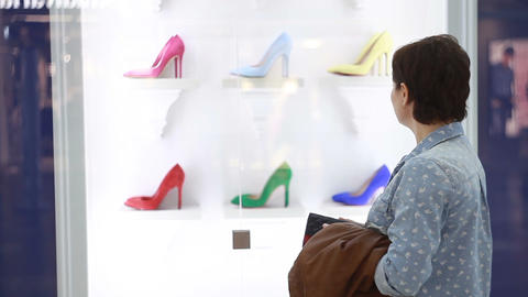 The girl is choosing fashionable shoes Live Action
