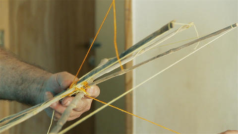 Man Building A Wooden Kite. Close-Up Footage