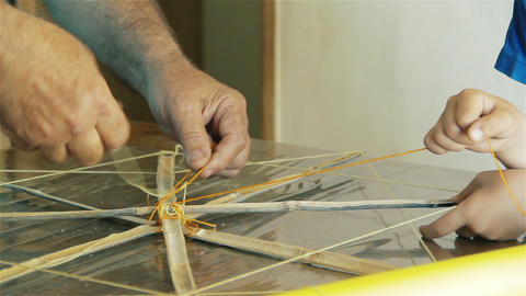 Father Making Kite Together With His Son Footage
