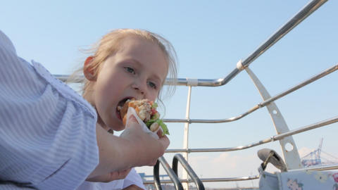 Little Girl Eating Hamburger Footage
