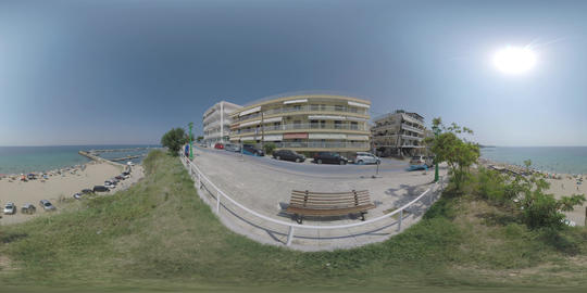 360 VR Hotels on waterfront and people at the beach in Nea Kallikratia, Greece ビデオ