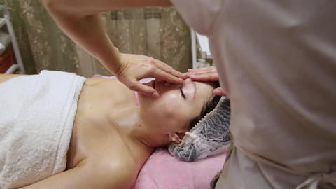 Spa woman facial Massage. Face Massage in beauty spa... Stock Video Footage