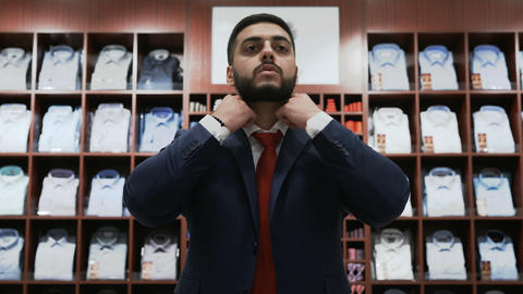Businessman choosing classical suit in the suit shop Stock Video Footage